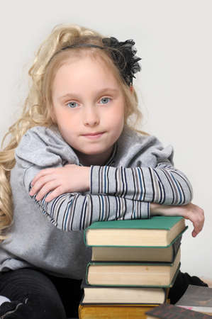 industrious: schoolgirl girl with a books