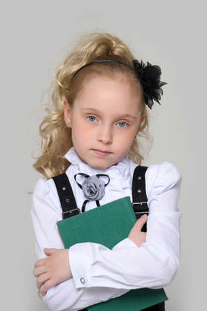 schoolgirl girl with a book in hand photo