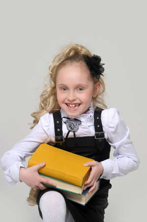 schoolgirl girl with a books in hands Stock Photo - 16194483