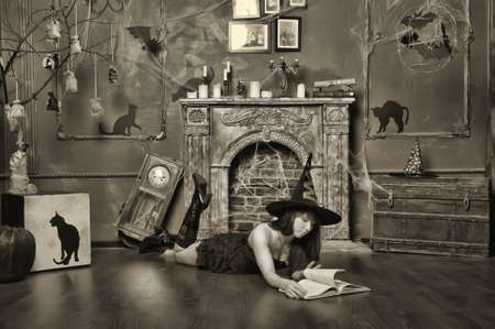 witch next to the fireplace Stock Photo - 16857111