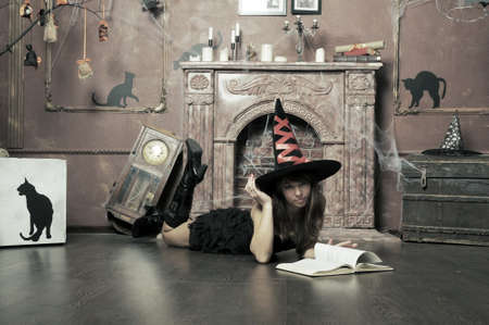 witch next to the fireplace photo