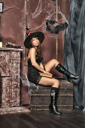 sooty: witch next to the fireplace Stock Photo