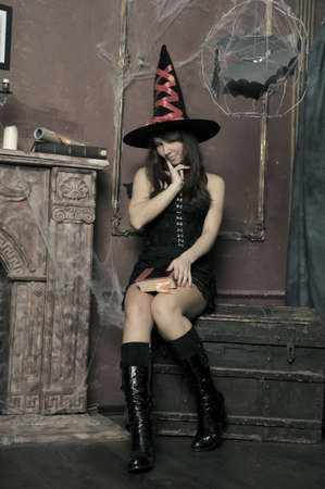 witch next to the fireplace Stock Photo - 16857112