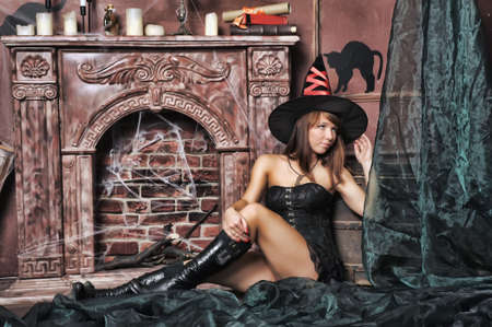 witch next to the fireplace Stock Photo - 16857104