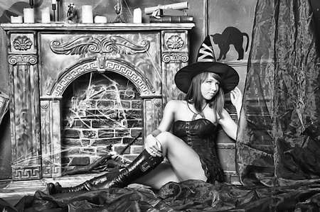 witch next to the fireplace Stock Photo - 16857094