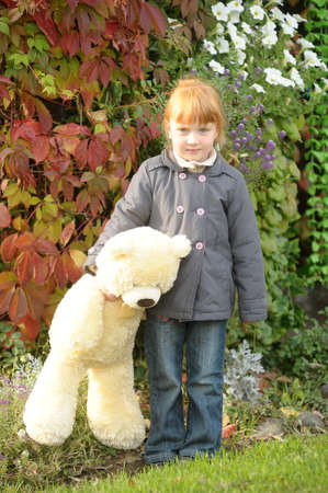 Child with toy bear cub photo