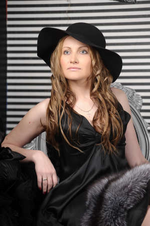 woman in black dress and black hat photo