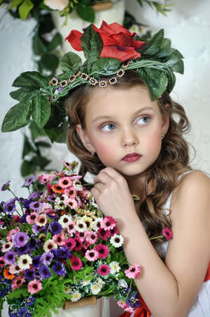 inocent: portrait of little girl with flowers