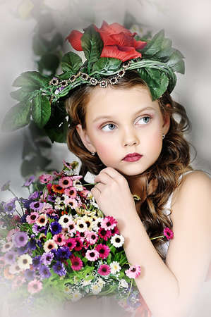 portrait of little girl with flowers Stock Photo - 16858885