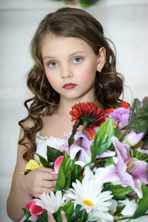 pigtail: girl with a bouquet of flowers Stock Photo