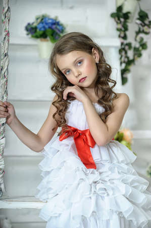 child girl nude: girl in a white dress on a swing