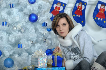 Young woman in a Christmas interior in blue tones  photo