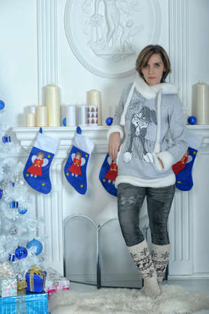 Young woman in a Christmas interior in blue tones Stock Photo - 16791087