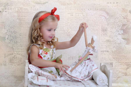 girl playing with a doll Stock Photo - 17923515