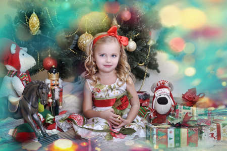 cute little girl in front of a Christmas tree Stock Photo - 16898887