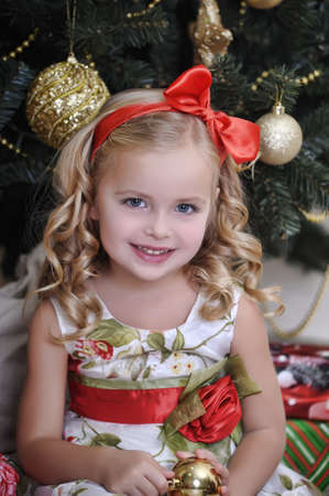 cute little girl in front of a Christmas tree
