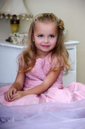 Beautiful little girl pink dress photo