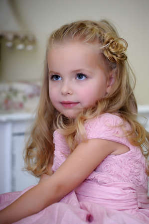Little girl in pink dress photo