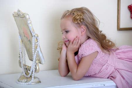 quiet baby: Little girl in pink dress