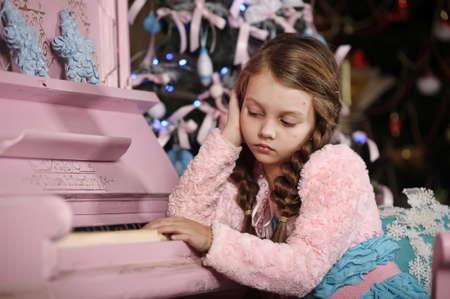 sad girl near the piano Stock Photo - 17260544