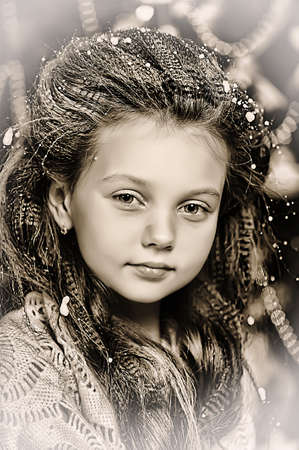 portrait of girl with snowflakes on hair photo