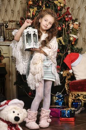 girl with gifts near a Christmas tree Stock Photo - 16889323