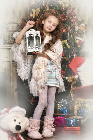 girl with gifts near a Christmas tree Stock Photo - 16889329