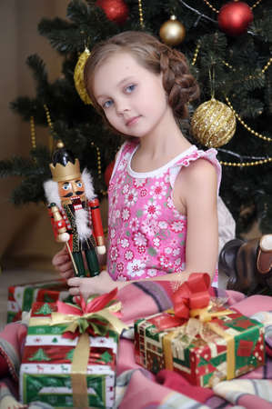 girl with gifts near a Christmas tree Stock Photo - 16889269