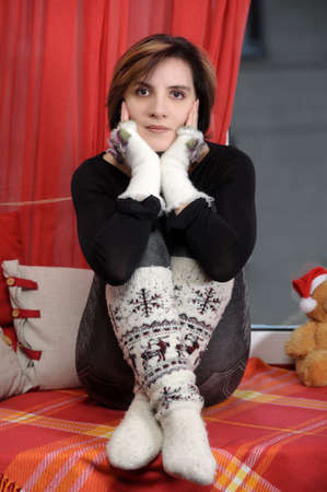 young woman in gloves and woolen socks photo