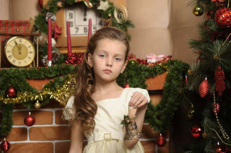 girl decorates the Christmas tree, in vintage style photo