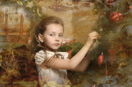 girl decorates the Christmas tree, in vintage style Stock Photo - 16889319