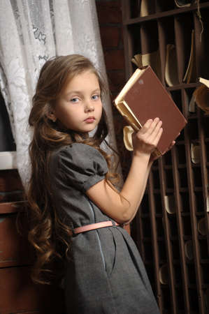 A young girl in library Stock Photo - 17084851
