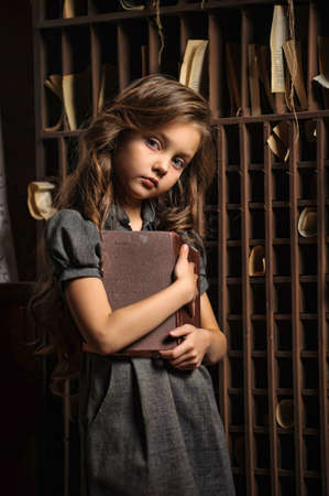A young girl in library