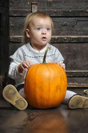 Halloween baby with pumpkins Stock Photo - 17458448