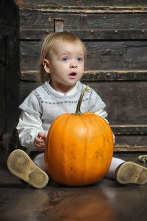 Halloween baby with pumpkins Stock Photo - 17458450