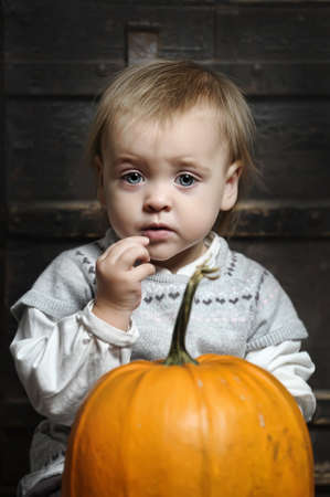 Halloween baby with pumpkins Stock Photo - 17458444