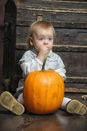 Halloween baby with pumpkins photo