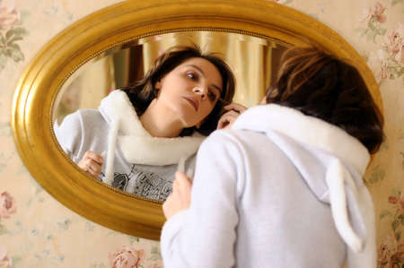 beautiful young woman in front of mirror Stock Photo - 16934541