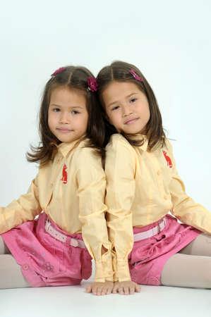 alike:  twin sisters