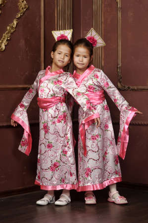Twin girls dressed in national costumes of Korea photo