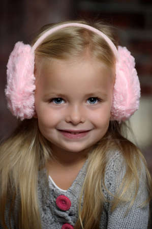 Sweet little child in  fur headphones Stock Photo - 18300568