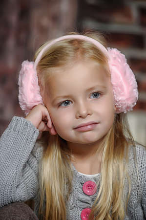 Sweet little child in  fur headphones photo