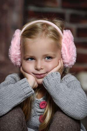 Sweet little child in  fur headphones Stock Photo - 18300572