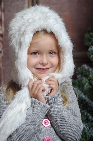 little girl in white fur bonnet photo