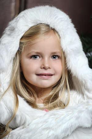 little girl in white fur photo