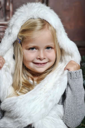 little girl in white fur bonnet photo