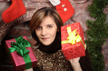 Young woman holding a Christmas gifts photo
