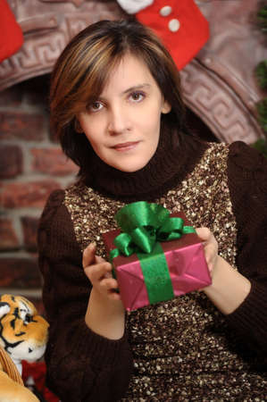Young woman holding a Christmas gifts Stock Photo - 17051580