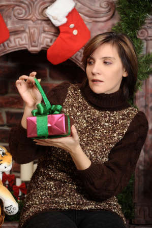 Young woman holding a Christmas gifts Stock Photo - 17051582