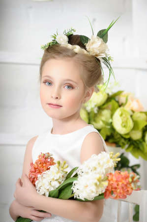 child girl nude: Girl with flowers Stock Photo